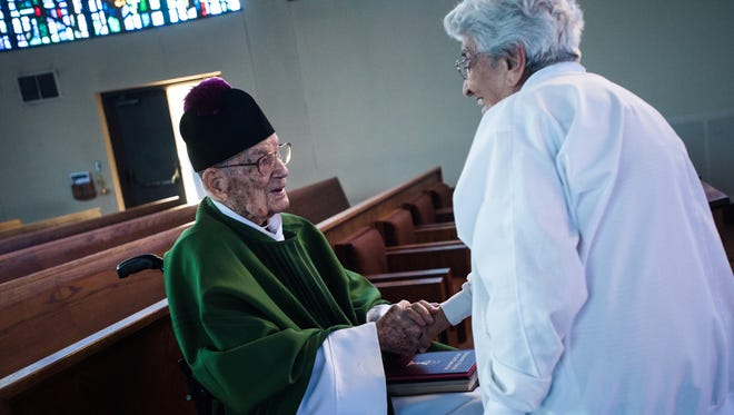 Parishioners greet Monsignor Vincent Topper after Mass on July 28, 2016 -- his 104th birthday -- at St. Catherine Labouré Roman Catholic Church in Harrisburg, Pa.