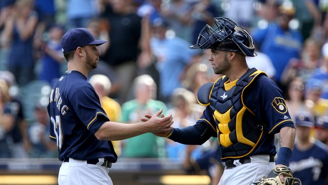 Tyler Thornburg and Manny Pina celebrate after the Brewers beat the Reds, 7-3, at Miller Park on August 14.