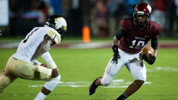 Prattville's Joshua Moore carries against Wetumpka