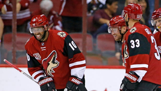 Arizona Coyotes' Anthony Duclair (10) celebrates his goal against the Anaheim Ducks with Max Domi, second from right, and Alex Goligoski (33) during the first period of a preseason NHL hockey game Saturday, Oct. 1, 2016, in Glendale, Ariz.
