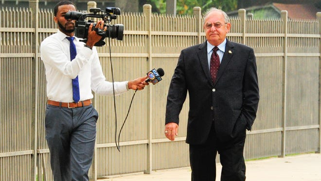 Iberia Parish Sheriff Louis Ackal arrives at the Federal Courthouse in Lafayette for arraignment.