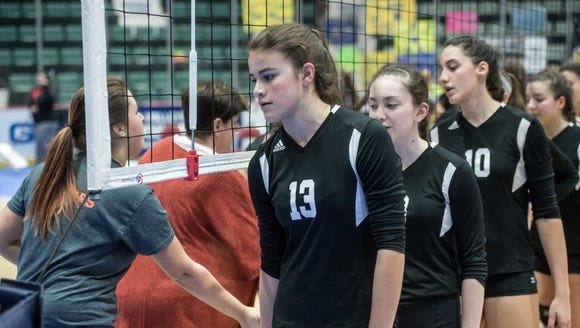 Pawlings' Laura Kuhlmann and her teammates shake hands