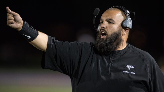 North Canyon's head coach Jose Lucero on the sideline of their high school football game against Arcadia on Friday, Oct. 7, 2016, at North Canyon High School in Phoenix, Ariz.