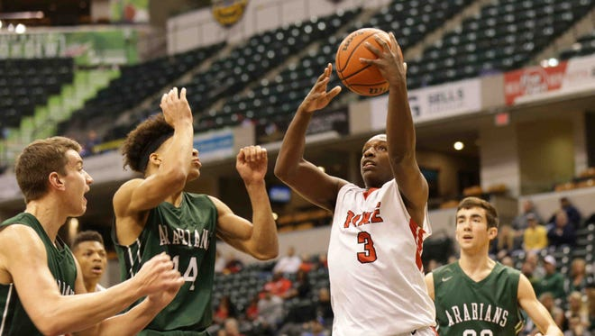 """Pike High School's Justin Williams (3) is fouled during """"The Really Big Basketball Show, 2017"""", held at Bankers Life Fieldhouse, Jan 28, 2017. Pendleton Heights High School vs. Pike High School."""