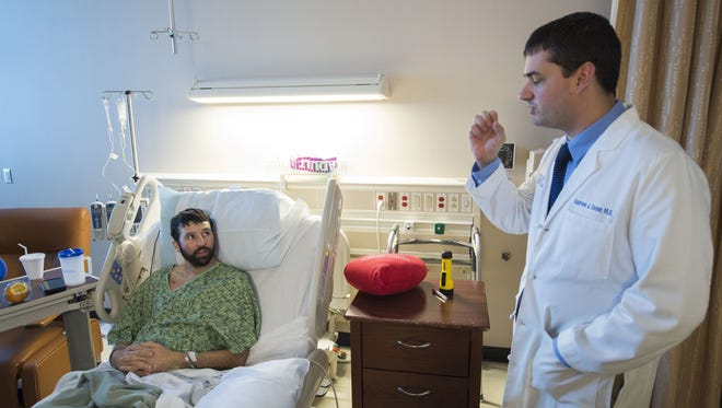 Zach Engelken, the fourth person to receive a heart through the new transplant program at the University of Kansas Hospital, talks with Andrew Sauer, medical director for heart transplant and advanced heart failure for the KU Health System.