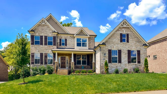 The Jones Co. is selling homes with finished basements in the Falls Grove subdivision in College Grove.