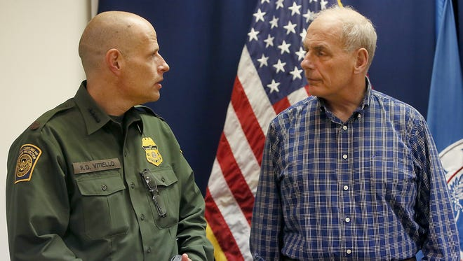 Department of Homeland Security Secretary John Kelly (right) talks with chief of U.S. Border Patrol, Ron Vitiello, at the Border Patrol station in Nogales, Ariz. on Thursday February 09, 2017.
