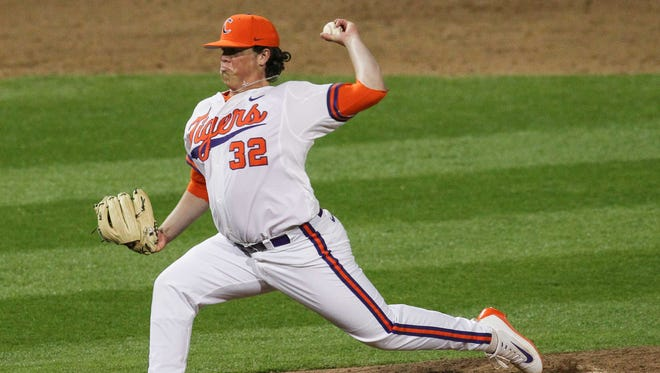 Clemson freshman pitcher Jacob Hennessy (32) throws against South Carolina during the top of the eighth inning on Friday at Doug Kingsmore Stadium in Clemson.