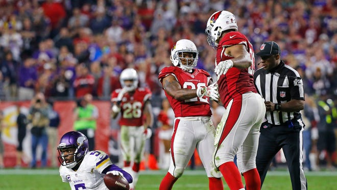 Arizona Cardinals strong safety Tony Jefferson (22) celebrates with Calais Campbell after stopping Minnesota Vikings quarterback Teddy Bridgewater (5)  late in the 4th quarter of their NFL game Thursday, Dec 10, 2015 in Glendale, Ariz.