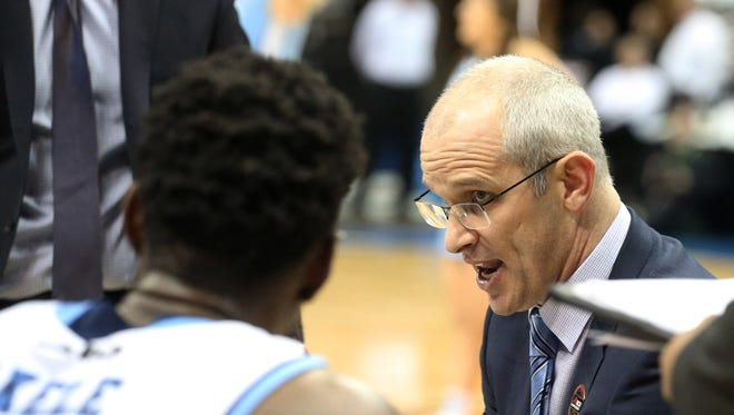 Mar 11, 2017; Pittsburgh, PA, USA; Rhode Island Rams head coach Dan Hurley (right) talks in the huddle during the second half against the Davidson Wildcats at the PPG Paints Arena. Rhode Island won 84-60.