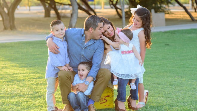 Laura Ciscomani with her husband and four (now five) children.
