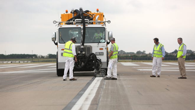 May 25, 2016 - Airfield maintenance employees make use of a new piece of equipment called the Stripe Hog to remove paint and rubber from runways and taxiways at Memphis International Airport. The unit uses water with up to 40K PSI to remove aged paint and excess rubber without damaging the concrete.