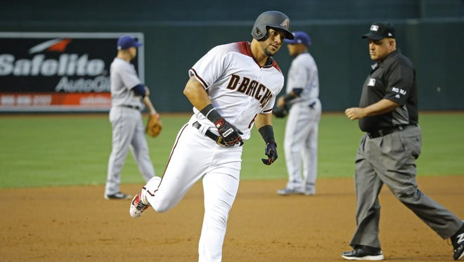 Diamondbacks right fielder David Peralta (6) rounds third base following his solo home run off Padres starter Jhoulys Chacin in the first inning of Monday's win.