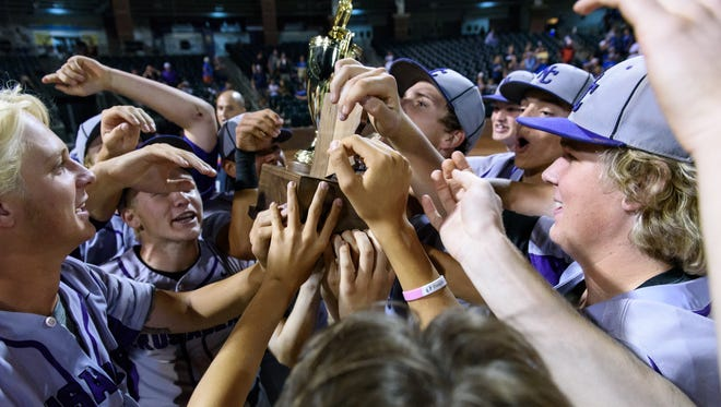 Northwest Christian celebrates their AIA 3A Baseball State championship win on Saturday, May 13, 2017, at Surprise Stadium in Surprise, Ariz.