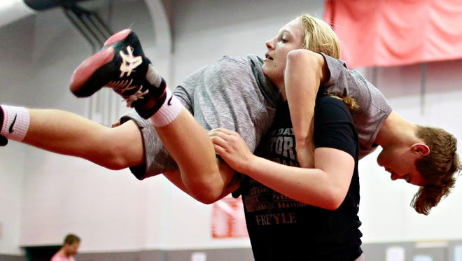 Tiffani McNelis, 14, of Stewartstown, lifts Mason Lewis, 15, of Dover, as they partner on drills during Modern Day Gladiators Wrestling Club practice at Dover Area High School in Dover, Thursday, May 18, 2017. McNelis will be competing in the 2017 Women's National Championships this weekend in Irving, Texas. Dawn J. Sagert photo