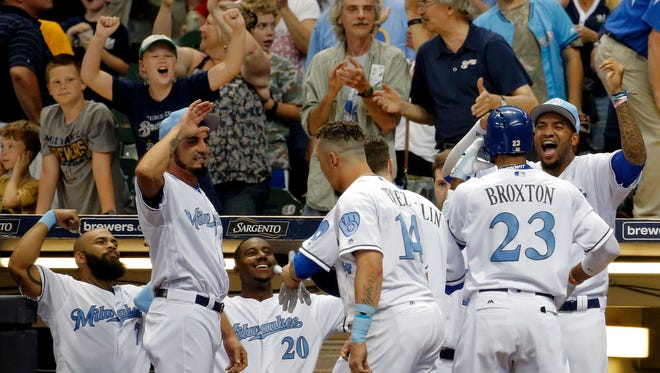 The Brewers celebrate a two-run homer by Keon Broxton against the Padres at Miller Park on June 17. In spring training, Jesus Aguilar and Eric Thames put together an impromptu receiving line in the dugout for teammates who hit home runs.