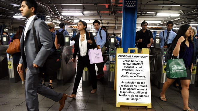 Commuters stream July 10, 2017, through the 33rd Street Port Authority Trans-Hudson station in Manhattan, rerouted through Hoboken, N.J., because of eight weeks of track work at Penn Station in Manhattan. The project is expected to last until Sept. 1.