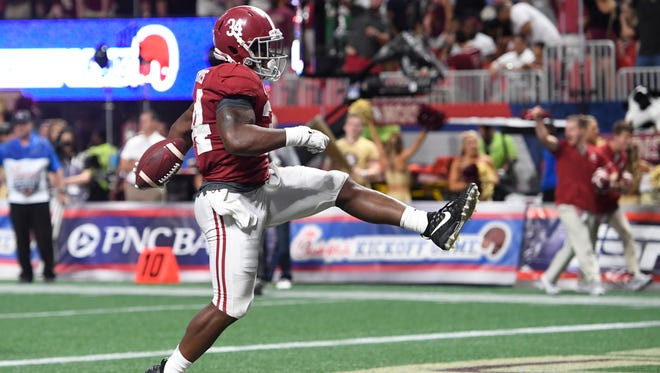 Alabama running back Damien Harris (34) scores a second half touchdown against Florida State in the Chick-fil-a Classic at the Mercedes - Benz Stadium in Atlanta, Ga., on Saturday September 2, 2017. (Mickey Welsh / Montgomery Advertiser)