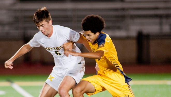 St. X. defender Michael Hagerty tries to keep Collegiate forward Cal LeDoux from the ball in the KHSAA 26th district boys soccer championship. 12 October 2017