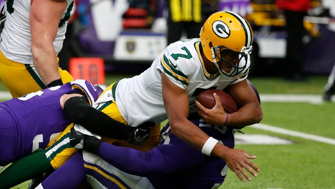 Green Bay Packers quarterback Brett Hundley (7) is tackled by Minnesota Vikings defensive end Brian Robison (96) and Linval Joseph (98) in the second half of an NFL football game in Minneapolis, Sunday, Oct. 15, 2017.