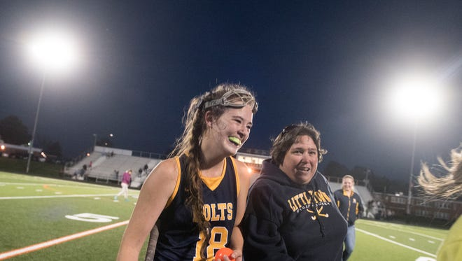 Littlestown's Savannah Schisler walks off the field with Bolts head coach after scoring the winning goal in overtime, Wednesday, October 25, 2017. The Littlestown Bolts topped the Hanover Hawkettes, 2-1, in overtime during the first round of District 3 playoffs.