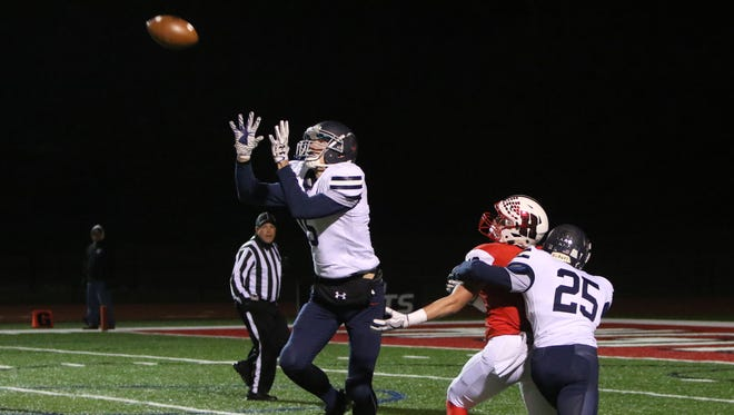 Brookfield East's Patrick Cartier intercepts a pass intended for Homestead's Matthew Hartlieb in the first quarter at Homestead on Oct. 27.