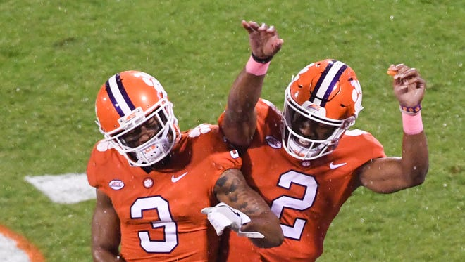 Clemson receiver Amari Rodgers (3) celebrates with quarterback Kelly Bryant(2) a touchdown play to wide receiver Deon Cain (8) against Georgia Tech during the first quarter in Memorial Stadium at Clemson on Saturday.