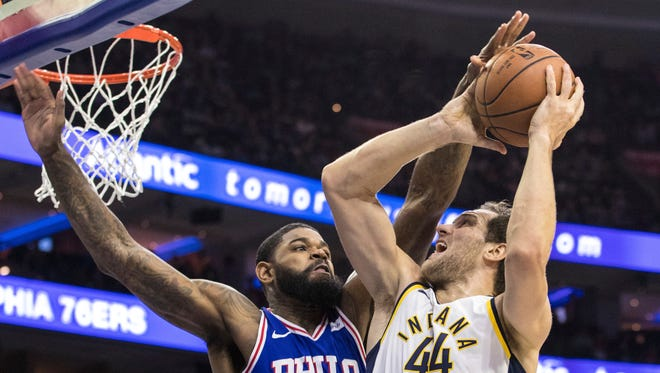 Indiana Pacers' Bojan Bogdanovic, right, goes up for a shot against Philadelphia 76ers' Amir Johnson during the first half of an NBA basketball game, Friday, Nov. 3, 2017, in Philadelphia.