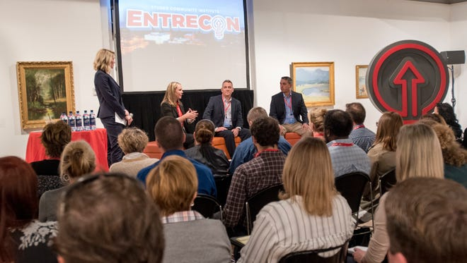 """Felicia Wynne, seated left to right, Tim Shoop, and Amir Fooladi participate in """"The Three C's of Customer Satisfaction: Consistency, Consistency, Consistency"""" panel during Entrecon in Pensacola on Tuesday, November 14, 2017."""