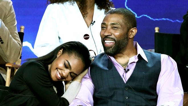 """China Anne McClain, left, and Cress Williams discussed """"Black Lightning"""" during the Television Critics Association's winter press tour in California"""