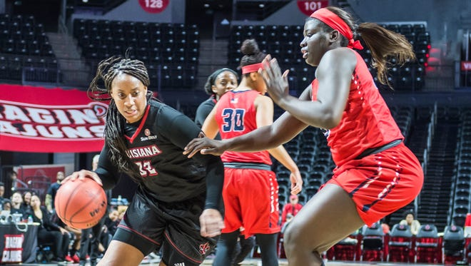 UL forward Simone Fields (32) works the ball to the basket against a South Alabama defender Thursday Jan. 25, 2018.