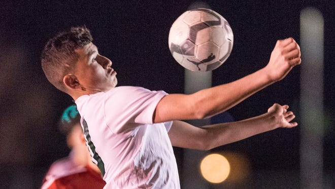 El Diamante's Jesus Garcia controls a kicked ball against Hanford in a West Yosemite League high school boys soccer game on Thursday, January 25, 2018.