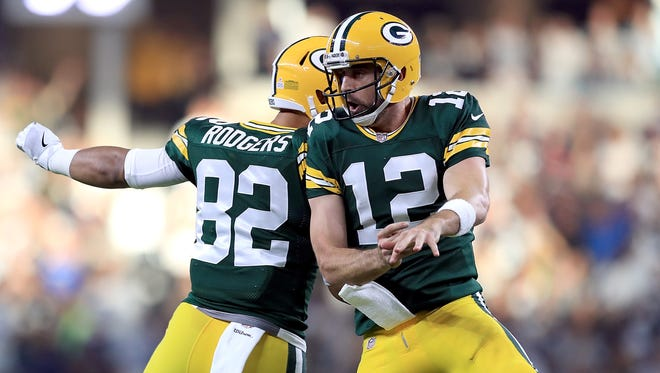 Aaron Rodgers (right) and Richard Rodgers celebrate the Packers' game-winning touchdown against the Cowboys on Oct. 8.