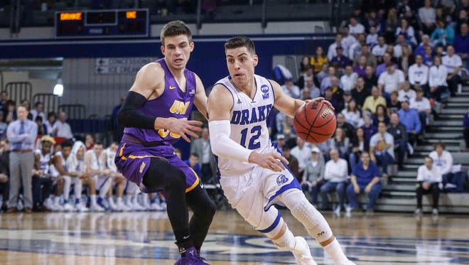 Drake senior Reed Timmer drives the ball up court against Northern Iowa at the Knapp Center at Drake University in Des Moines.