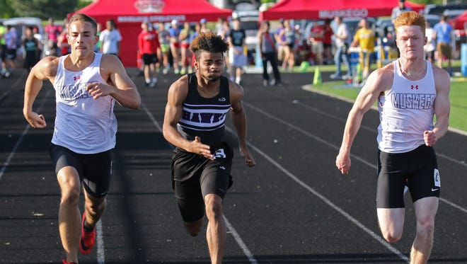 Muskego's Sam Scholz (left) and RJ Bosshart battle Kenosha Indian Hill's Jaylen Grant in the 100-meter dash durinig the Mukwonago sectional meet at Mukwonago High School on May 24.