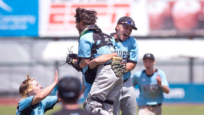The South Burlington Wolves react after the final out of their 5-3 win over Colchester in the Division I state championship game on Saturday at Centennial Field.