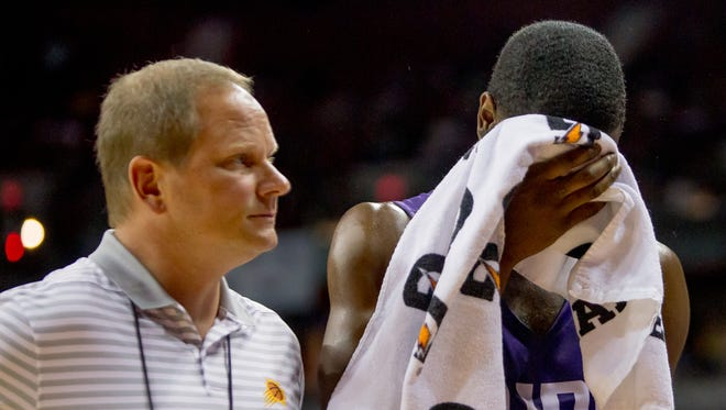 Phoenix Suns forward Josh Jackson (20) walks back to the bench after being injured on July 7, 2018, during the Phoenix Suns' NBA Summer League matchup against the Sacramento Kings at the University of Nevada Las Vegas.