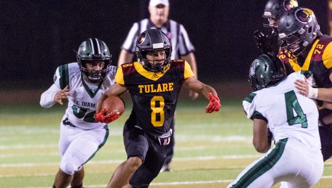 Tulare Union's Devan Moore runs against El Diamante in a non-league high school football game on Thursday, August 23, 2018. Tulare Union is one of eight remaining Tulare County teams who are currently undefeated through Week 2.