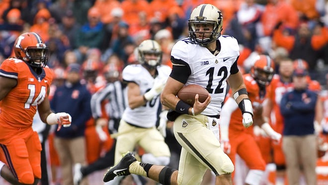 Mike Granse/USA TODAY Purdue quarterback Austin Appleby rushed for 76 yards and passed for 202 against Illinois on Saturday at Memorial Stadium. Oct 4, 2014; Champaign, IL, USA; Purdue Boilermakers quarterback Austin Appleby (12) carries the ball against the Illinois Fighting Illini at Memorial Stadium. Mandatory Credit: Mike Granse-USA TODAY Sports