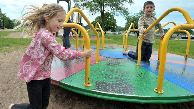 Milana Hanson of Wausau, then 5, pushes a merry-go-round with Alex Ruiz, 6, of Weston, right, and her brother, Alex Hanson, 3, aboard at Kennedy Park's playground in Weston in this 2013 photo.