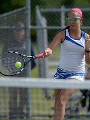 Centerville's Chloe Uphaus returns the ball while playing in the TEC tennis tournament Monday, May 16, 2016 at Northeastern in Fountain City.
