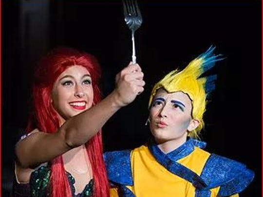 "Ariel (Anna Laine) and Flounder (Kaitlyn Hornsby) wonder in amazement at a ""dinglehopper"" in Mother of Mercy's ""The Little Mermaid."""