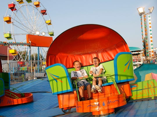 Blacke Frazee (left) and Ethan Mock ride the Tilt-A-Whirl during the annual Selma Bluebird Days event in this photo from 2011.