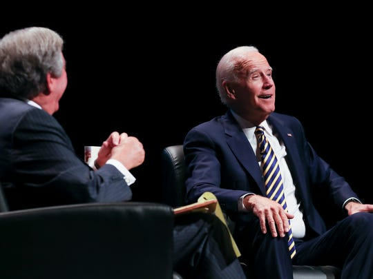 """Former Vice-President Joe Biden, right, smiled as he spoke with former Louisville Mayor Jerry Abramson during a discussion on Biden's book tour for """"Promise Me, Dad—A Year of Hope, Hardship, and Purpose"""" at The Kentucky Center for the Performing Arts.June 7, 2018"""