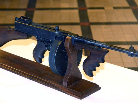 A Thompson submachine gun that John Dillinger's gang stole from a northeastern Indiana police station more than 80 years ago has been returned, finally, and will go on display. It rests March 6, 2014 at the DeKalb County Courthouse during a ceremony in Auburn, Ind. The gun has an estimated value of up to $1 million.