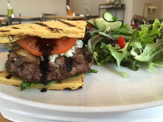 At BFF Café, an 8-ounce bison burger is served on falafel or cauliflower flatbread.