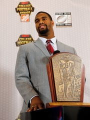 Alabama's Jonathan Allen stands behind the Chuck Bednarik Award for College Defensive Player of the Year as he speaks to reporters Thursday, Dec. 8, 2016, in Atlanta. (AP Photo/John Bazemore)