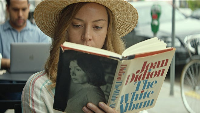 "In ""Ingrid Goes West,"" Ingrid (Aubrey Plaza) gets in some reading."