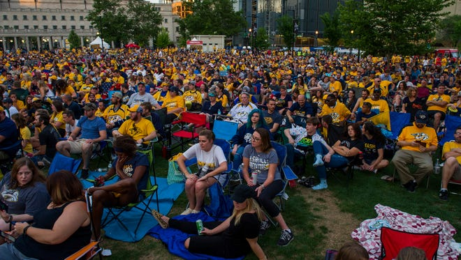 Fans watch the Nashville Predators play in Game 1 of the Stanley Cup Final at Music City Walk of Fame Park in Nashville, Tenn., Monday, May 29, 2017.