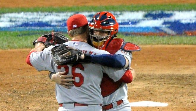 Trevor Rosenthal celebrates with catcher Yadier Molina after winning Game 2.
